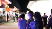 atlıkarınca : PARIS, FRANCE - CIRCA 2018: Middle-eastern ethnicity family walking at night in the amusement park France Europe lots of neon lights, kiosks and funny atmosphere