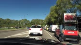dżem : STRASBOURG HOENHEIM, FRANCE - CIRCA 2018: Driver POV at cars in traffic jam before entering the A350 national highway national route from Avenue Herrenschmidt road on a newly asphalted road in France - Driver POV sunny clear sky Wideo