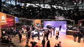 sala de exposição : PARIS, FRANCE - OCT 4, 2018: Elevated view of hundreds of customers curious people admiring new luxury Citroen mini car at International car exhibition Mondial Paris Motor Show Stock Footage