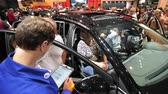 revendedor : PARIS, FRANCE - OCT 4, 2018: Customers curious people inside Citroen car being instructed by car seller about the options of the particular model at International car exhibition Mondial Paris Motor Show,