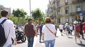 tied up : BARCELONA, SPAIN - CIRCA 2018: Cinematic POV while walking at Commuters people crossing the street in Barcelona center - slow motion slowmotion street cityscape on warm summer day