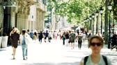 pendulares : Street crowd slowmotion slow motion in central of the European boulevard with long perspective hundreds of people commuting on a warm day to work home visiting city