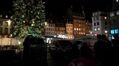 sylwester : STRASBOURG, FRANCE - CIRCA 2018: Christmas market in Place Kleber with people waiting to see the decorated Christmas fir tree in central Place Kleber in the evening