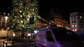 adwent : STRASBOURG,  FRANCE - CIRCA 2018: Team in telescopic crane rising to decorate the Christmas tree in central Place Kleber - arranging toys before the winter holiday annual market in Strasbourg
