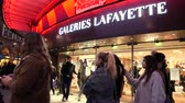 galeria : STRASBOURG, FRANCE - DEC 23, 2017: Customers shopping in the winter evening a few days before Christmas in France at galleries Lafayette in central Strasbourg - square image