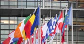 conference room : STRASBOURG, FRANCE - CIRCA 2018: Close-up of European Parliament headquarter facade building with flags of all member states waving - slow wind newsworthy 4k DCI Stock Footage