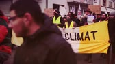 protester : STRASBOURG, FRANCE - DEC 8, 2018: Crowd marching in Central Strasbourg at the nationwide protest demonstration Marche Pour Le Climate - crowd yelling NON au GCO Grand Contournement Ouest de Strasbourg vhs vintage tape