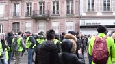 protester : STRASBOURG, FRANCE - DEC 8, 2018: Green yellow wests yelling on street Macron Demission Macron Resign during the nationwide day of protest Stock Footage