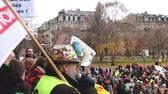 протест : STRASBOURG, FRANCE - DEC 8, 2018: Man addressing to crowd the nationwide protest Marche Pour Le Climate in front of Strasbourg University speech against GCO Grand Contournement Ouest de Strasbourg