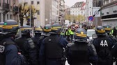 disputa : STRASBOURG, FRANCE - DEC 8, 2018: Police officers securing the zone in front of the Yellow vests movement protesters on Quai des Bateliers street