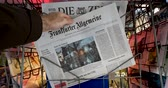 newspaper stack : PARIS, FRANCE - DEC 10, 2018: Newspaper stand kiosk stand selling press with man buying Frankfurter Allgemeine newspaper featuring protests of yellow vests in Strasbourg