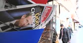 newspaper stack : PARIS, FRANCE - DEC 10, 2018: Newspaper stand kiosk stand selling press Aujourdhui Today newspaper featuring Emmanuel Macron on the front page