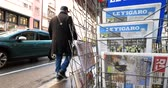 newspaper stack : PARIS, FRANCE - DEC 10, 2018: Newspaper stand kiosk stand selling press with multiple French newspapers, lOpinion, Express, Le monde, Le figaro, Monde Economique, Les Echos, La Tribune Stock Footage