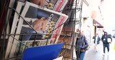 newspaper stack : PARIS, FRANCE - DEC 10, 2018: Newspaper stand kiosk stand selling press Aujourdhui Today newspaper featuring Emmanuel Macron on the front page pedestrians in background