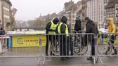 gözetim : STRASBOURG, FRANCE - DEC 11, 2018: Side view of police surveilling the entrance to Strasbourg Christmas Market near city center in Strasbourg during winter holidays after terrorist attack - city center surveillance Stok Video