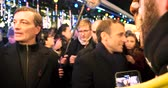 pov : STRASBOURG, FRANCE - DEC 14, 2018: Handheld video of smiling French President Emmanuel Macron shakes hands with members of a crowd at Christmas Market after paying tribute for victims of terrorist attack on 11 December