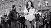 leading : STRASBOURG, FRANCE - MAY 14, 2016: Slow walk performance protest in central Strasbourg square, Place Kleber with group of young and adult people walking in slow motion deliberately - black and white