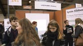de volta à escola : STRASBOURG, FRANCE - CIRCA 2018: Children and teens of all ages attending annual Education Fair to choose career path and receive vocational counseling - Lycee Kleber stand Vídeos