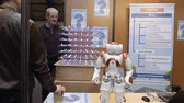 robô : STRASBOURG, FRANCE - CIRCA 2018: Robot motion making diverse karate martial arts gestures at technical IT college stand during Education Fair