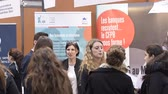 dráha : STRASBOURG, FRANCE - CIRCA 2018: Children and teens of all ages attending annual Education Fair to choose career path and receive vocational counseling - bank stand recruiting