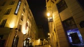 albergue : Paris, France - Circa 2019: Accor Mercure Paris Gare de lEst Magenta hotel pan with perspective over tiny French street at night Archivo de Video