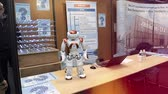 空手 : STRASBOURG, FRANCE - CIRCA 2018: Robot motion making diverse karate martial arts gestures at technical IT college stand during Education Fair