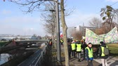 security measures : STRASBOURG, FRANCE - FEB 02, 2018: People demonstrating walking during protest of Gilets Jaunes Yellow Vest manifestation at European Parliament in Strasbourg protected by Police vans