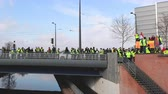 security measures : STRASBOURG, FRANCE - FEB 02, 2018: People demonstrating on Pont Joseph Bech during protest of Gilets Jaunes Yellow Vest manifestation anti-government demonstrations European Parliament