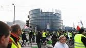eleição : STRASBOURG, FRANCE - FEB 02, 2018: Gilets Jaunes Yellow Vest manifestation people demonstrating walking during protest central Strasbourg in front of European Parliament Vídeos