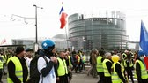 security measures : STRASBOURG, FRANCE - FEB 02, 2018: People demonstrating walking during protest of Gilets Jaunes Yellow Vest manifestation on the 12 Saturday of anti-government demonstrations
