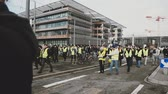 strike : STRASBOURG, FRANCE - FEB 02, 2018: Handheld POV walking with crowd at demonstration of Gilets Jaunes Yellow Vest manifestation on the 12 Saturday of anti-government demonstrations Stock Footage