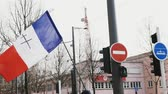 марш : STRASBOURG, FRANCE - FEB 02, 2018: People demonstrating with French flag with black orthodox cross during protest of Gilets Jaunes Yellow Vest manifestation on the 12 Saturday of anti-government demonstrations Стоковые видеозаписи