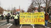 security measures : STRASBOURG, FRANCE - FEB 02, 2018: This is a rebellion, no sir, this is a revolution placard held by Gilets Jaunes Yellow Vest manifestation on the 12 Saturday of anti-government demonstrations