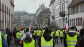 security measures : STRASBOURG, FRANCE - FEB 02, 2018: Thousands of Gilets Jaunes Yellow Vest protesters walking at manifestation on the 12 Saturday of anti-government demonstrations