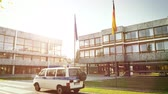 supremo : Karlsruhe, Germany - Oct 29, 2017: Volkswagen police polizei van surveillance Federal Constitutional Court building Bundesverfassungsgericht with Eu and German flag waving cinematic sunligh flare