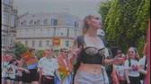 partnership : STRASBOURG, FRANCE - CIRCA 2018: VHS vintage film effect over large crowd of people waving rainbow flags at annual FestiGays pride gays and lesbians parade marching on French streets dancing fun party feelings