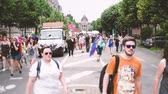 transgender : STRASBOURG, FRANCE - CIRCA 2018: Large crowd of people waving rainbow flags at annual FestiGays pride gays and lesbians parade marching on Avenue de la Liberte Freedom Avenue Stock Footage