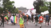 sexualität : STRASBOURG, FRANCE - CIRCA 2018: Large crowd of people waving rainbow flags at annual FestiGays pride gays and lesbians parade marching on Avenue de la Liberte Freedom Avenue toward Strasbourg University Videos