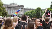 droits : STRASBOURG, FRANCE - CIRCA 2018: People waving rainbow LGBT, EU and NATO flags at annual FestiGays pride parade marching in front University dancing fun party atmosphere Vidéos Libres De Droits