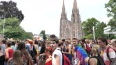 sexualität : STRASBOURG, FRANCE - CIRCA 2018: Large crowd of people waving rainbow flags at annual FestiGays pride happy gays and lesbians parade marching in front of Reformed Church Saint Paul