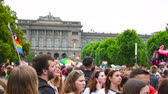 lesbian : STRASBOURG, FRANCE - CIRCA 2018: Large crowd of people waving rainbow LGBT, Eu and NATO flags at annual FestiGays pride parade marching in front University dancing fun party atmosphere