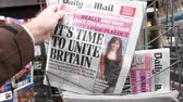 gazetecilik : Paris, France - Mar 12, 2019: British newspaper The Times featuring on the cover text that its time to unite Britain after Brexit Stok Video