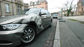 bieg : Strasbourg, France - Mar 12, 2019: Panning to luxury BMW German car parked on city street with damaged front by accident on the road
