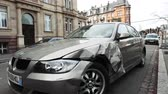 bieg : Strasbourg, France - Mar 12, 2019: Tilt-down to luxury BMW German car parked on city street with damaged front by accident on the road
