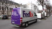 uwaga : Strasbourg, France - Circa 2019: Rear view of new Mercedes-Benz Sprinter van with FedEx parcel courier delivery logotypes leaving parking space after parcel delivery