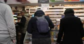 dergi : Paris, France - Mar 15, 2019: People shopping in queue inside tobacco press kiosk buying newspapers, cigarettes and lotto tickets