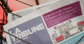buy press : Paris, France - Mar 15, 2019: French la Tribune newspaper writing news from UK British MPs have voted for a delay in the Brexit process for three months or more newspaper Stock Footage