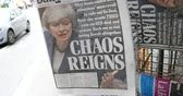 pausa : Paris, France - Mar 15, 2019: British MPs have voted for a delay in the Brexit process for three months or more newspaper Daily Mail with cover featuring Chaos Reign title with Theresa May Stock Footage