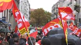 macron government : Strasbourg, France - Sep 12, 2017: Tens of red CGT flags waving at political march during a French Nationwide day of protest against the labor reform proposed by Emmanuel Macron Government