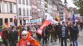 gözetim : Strasbourg, France - Sep 12, 2017: Young and adult people at large political march during a French Nationwide day of protest against the labor reform - blocking closing street thousands of people
